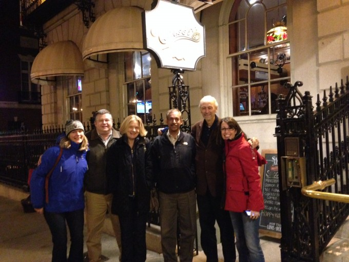 """Team standing in front of """"Cheers"""" sign in Boston"""