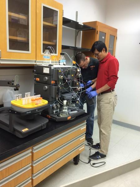 Lab members assembling a machine